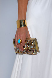 Cheryl's gold cuff bracelet is the perfect accompaniment to her Grecian gown.