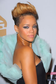 At this Grammy pre-party Rihanna showed off her newly structured fauxhawk. She is one of the only females who can make such an edgy haircut look feminine.