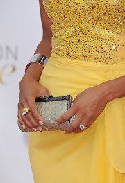 Eva la Rue polished off his glam ensemble at the Monte Carlo TV Festival with a silver beaded clutch.