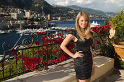 Kim Matula looked chic wearing a dotted mini dress at a cocktail party for Monte Carlo TV Fest.