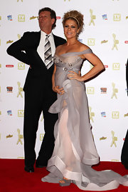 Natalie Bassingthwaighte's baby bump was visible through her sheer chiffon gown at the 52nd TV Week Logie Awards.