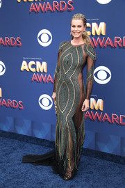 Rebecca Romijn looked seductive at the 2018 ACM Awards in a partially sheer Uel Camilo gown with strategically placed beading.