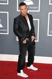Mike dons bright white leather sneakers with his dark attire at the Grammys.