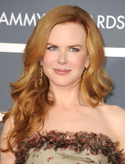 Actress Nicole Kidman was a sensation on the red carpet at the 2011 Grammy Awards. She paired her Jean Paul Gaultier gown with 19th Century emerald and gold pendant earrings.
