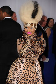 "Nicki Minaj never rocks one hairstyle for long. The 'Moment 4 Life"" singer rocked a leopard print Afro complete with a black stripe."