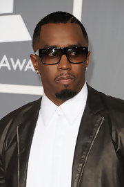Sean Combs attended the Grammy Awards wearing rectangular sunglasses with his black leather jacket.