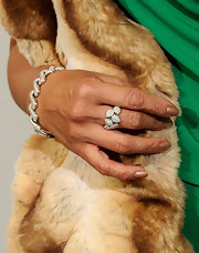 Tia Carrere was dressed to impress at the Grammy's with this ornate diamond ring and other luxurious accessories.
