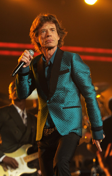 Mick Jagger took to the stage  in a quilted teal blazer with black lapels and pockets at the 53rd Annual Grammy Awards.