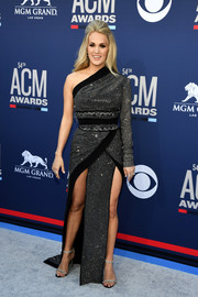 After giving birth, Carrie Underwood made a red carpet return at the 2019 ACM Awards wearing a double-slit one-shoulder gown by Nicolas Jebran.