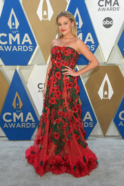 Kelsea Ballerini went the ultra-feminine route in a strapless floral corset gown by Dolce & Gabbana at the 2020 CMA Awards.