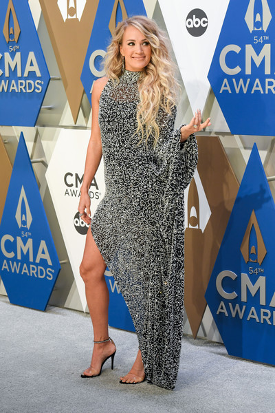 Carrie Underwood was diva-glam in an asymmetrical black gown with all-over silver beading at the 2020 CMA Awards.
