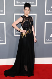 Shawna Thompson looked smashing at the Grammys in a sheer-panel black evening dress with gold embellishments.