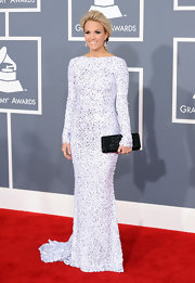 Country music diva Carrie Underwood loves to load up on sparkle. For the Grammys she did so with extra luster in this white glittering Gomez-Gracia gown. The simplicity of the cut let the bedazzled fabric do the talking.
