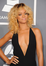 Rihanna attended the 54th Annual Grammy Awards wearing her newly flaxen locks in tousled curls.