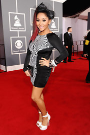Nicole Polizzi showed off her much-discussed shrunken figure at the Grammys. The Jersey Shore star replaced her signature pouf with an oversize bow in her fiery red locks. This black-and-white spandex number is so very Snooki.