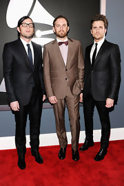 Jared Followill managed to look both elegant and edgy at the Grammys in his skinny suit.