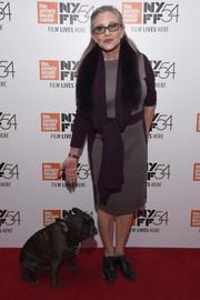 Carrie Fisher attended the New York Film Festival photocall for 'Bright Lights' wearing a gray and purple midi dress.