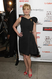 Martha Plimpton flaunted her black dress, which she paired with peep toe red heels.
