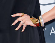 Jennifer Lopez used her jewelry to make her Grammy look pop, especially with this shiny gold cuff bracelet.
