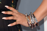 Ashanti piled on the bangles for a funky, eclectic look at the 2013 Grammys.