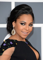 To draw attention to her face, Ashanti chose a bold dangle earring instead of over-the-top makeup.