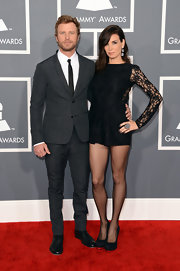Dierks Bentley opted for a less country-inspired look in favor of a simple gray suit on the 2013 Grammys red carpet.