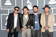 Marcus Mumford rocked classic Wayfarers at the 2013 Grammy Awards red carpet.