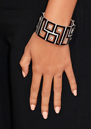Beyonce opted for a geometric black and white cuff bracelet to complement her black and white gown at the 2013 Grammys.