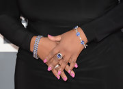 Anita Baker added some color to her all black dress with a pair of blue jeweled bracelets.