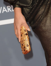 Tamia kept her look boho-chic with a stylish head turban and a gold and gemstone inlaid clutch at the 2013 Grammys.
