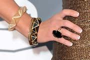 Nancy O'Dell added some color to her jewelry with cream and black geometric bangles at the 2013 Grammys.