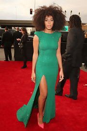 Always one for the unexpected, Solange rocked a bright green dress with coral shoes on the Grammy red carpet.