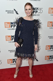 Julianne Moore got frilled up in a navy Chanel Couture cocktail dress with a feathered hem and shoulders for the New York Film Festival screening of 'Wonderstruck.'