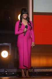 Mickey Guyton spoke onstage at the 2021 ACM Awards wearing an elegant fuchsia dress.