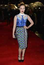 Holliday Grainger let her mixed prints stand out, choosing solid black platform pumps for her feet.