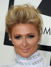 Paris Hilton rocked a messy-chic pompadour at the Grammys.
