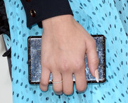Zendaya Coleman opted for a simple black box clutch by Edie Parker when she attended the 2014 Grammys.