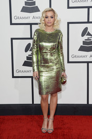 Rita Ora was all aglow in a shimmery lime green cocktail dress by Lanvin during the Grammys.