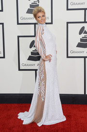 Paris Hilton was equal parts sultry and elegant at the Grammys in a high-neck white House of Milani gown with sheer detailing on the sleeves and back.