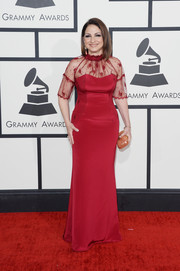 Gloria Estefan chose a pretty and romantic red lace-panel gown by Gustavo Cadile for the Grammys.