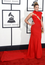 Colbie Caillat was a stunner at the Grammys in a red Ezra Santos gown with a floral-appliqued bodice, sheer detailing, and an ultra-long train.