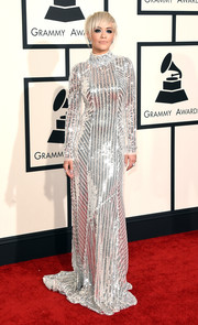 Rita Ora got all sparkled up in a fully sequined, long-sleeve, and high-neck Prada gown for the Grammys.