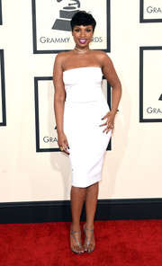 Jennifer Hudson went the minimalist route in a white strapless dress by Tom Ford during the Grammys.