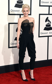 Gwen Stefani attended the Grammys looking oh-so-cool (as always) in a strapless black Atelier Versace jumpsuit featuring sheer, architectural detailing on the bodice.