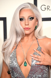 Lady Gaga adorned her low neckline with a gorgeous emerald pendant necklace by Lorraine Schwartz.
