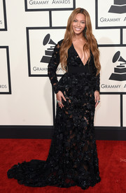 Beyonce Knowles looked sensual at the Grammys in a beaded, black Proenza Schouler gown that showed off cleavage and skin with its deep-V neckline and semi-sheer fabric.