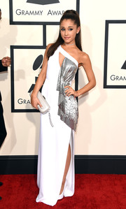 Ariana Grande chose a white Versace one-shoulder gown with a high side slit and a draped silver accent for her Grammys red carpet look.