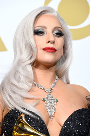 Lady Gaga rounded out her stunning look with a diamond chandelier necklace by Lorraine Schwartz.