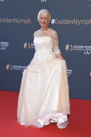 Helen Mirren was demure and regal in an embroidered white gown at the Monte Carlo TV Festival closing ceremony.