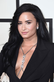 Demi Lovato wore her raven hair long with a side part and barely-there waves during the Grammys.